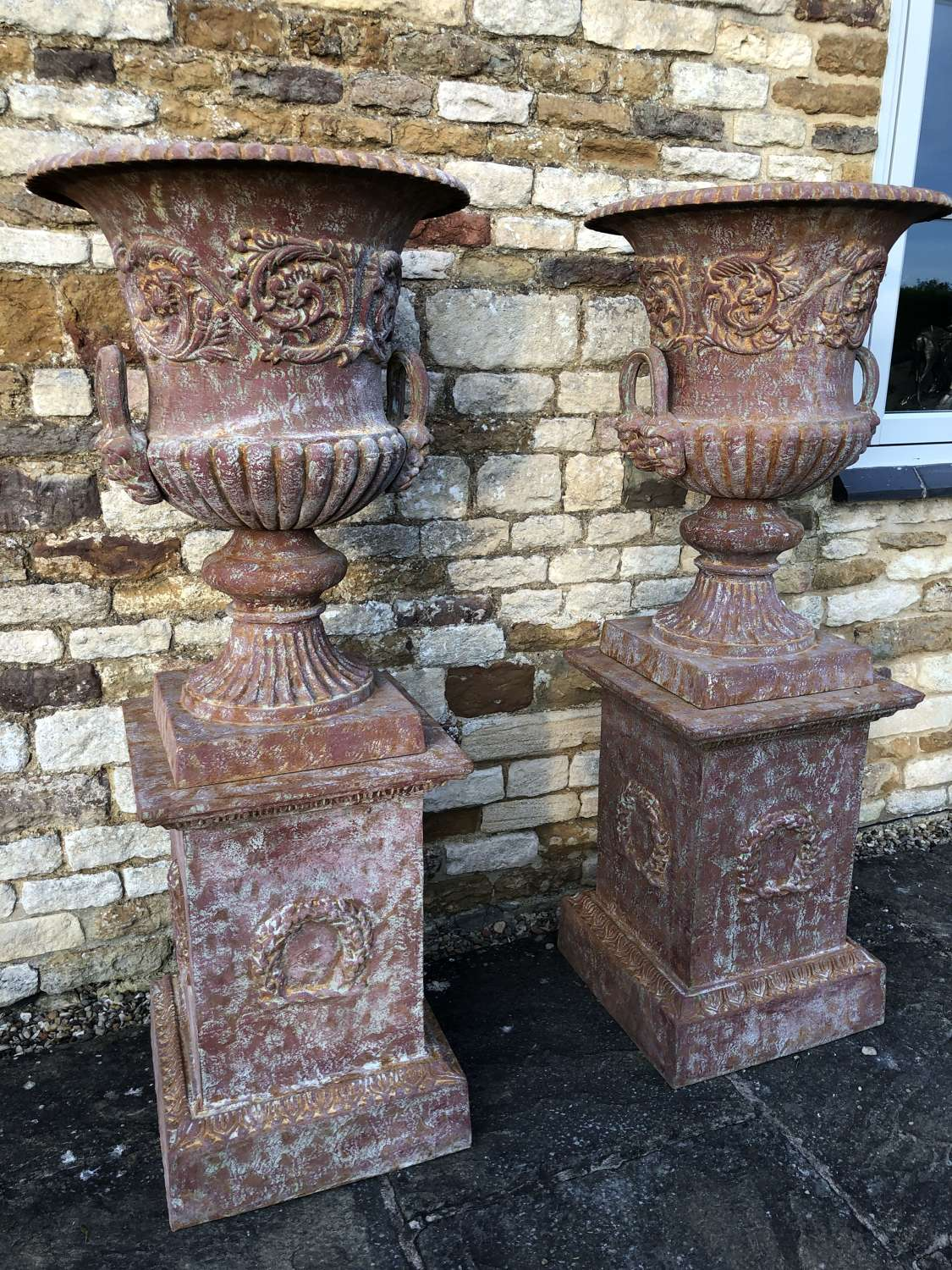 Pair of cast iron campagna urns & plinths 138 cm
