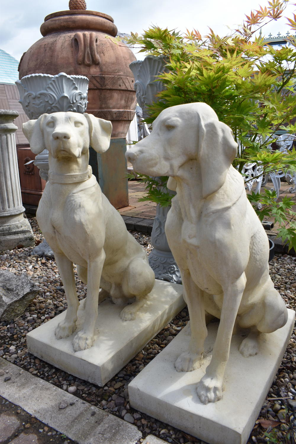 Pair of Jacquemart hunting dogs by Haddonstone.
