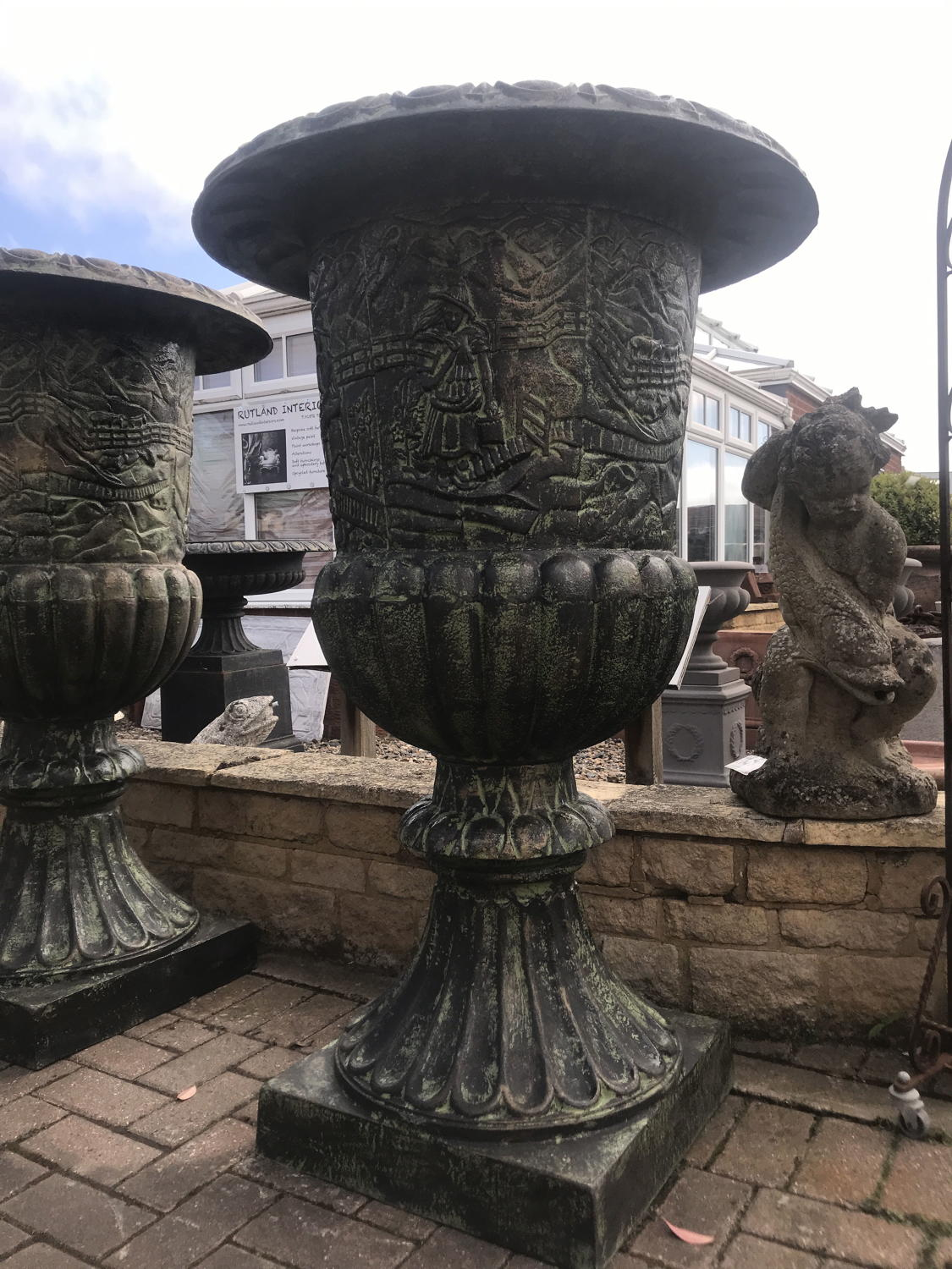Large pair of cast iron urns 126 cm tall