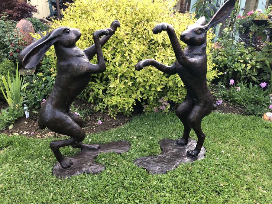 Pair of bronze boxing hares