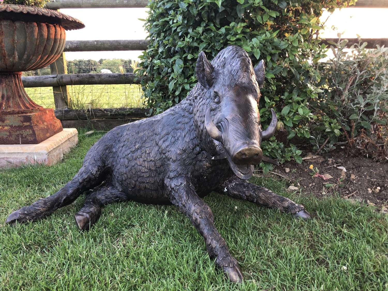 Bronze laying wild boar