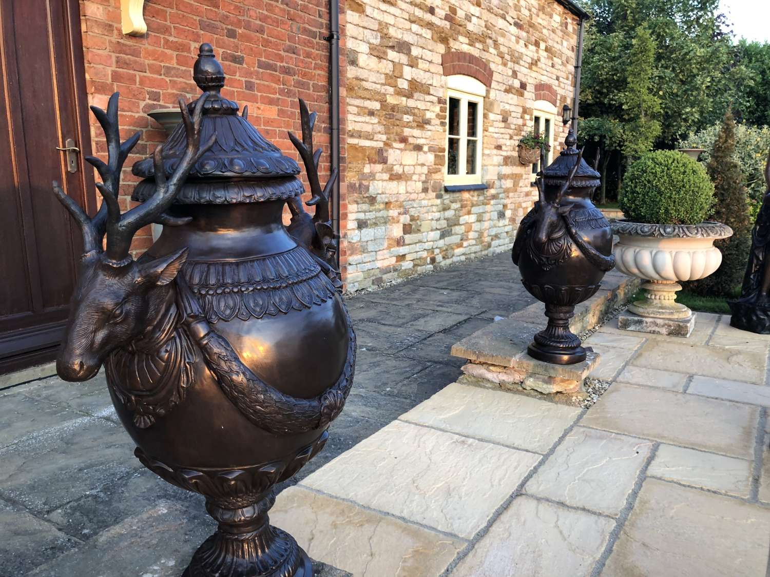 Pair of bronze stag head vases - bronze stag urns