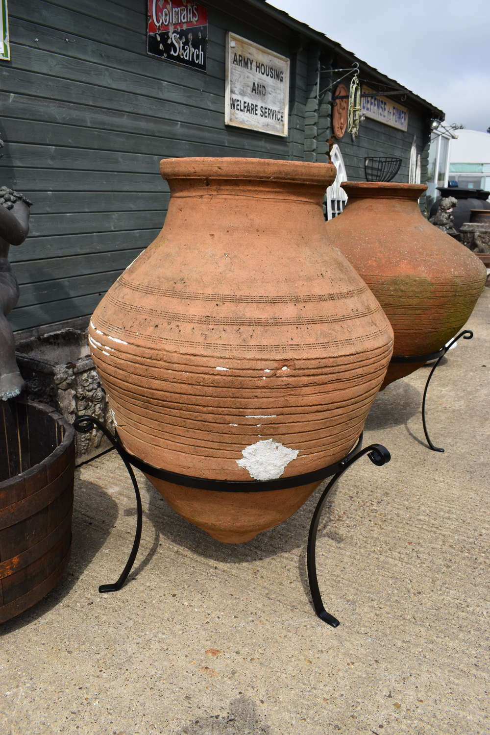 Large Antique olive jar in stand