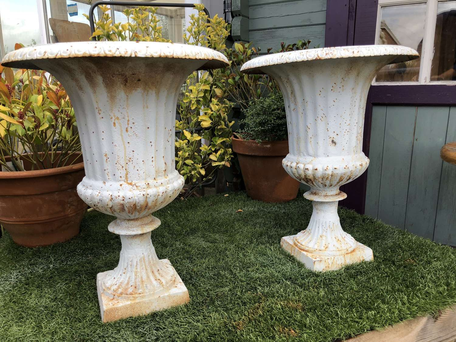 Pair of cast iron campagna urns 62 cm