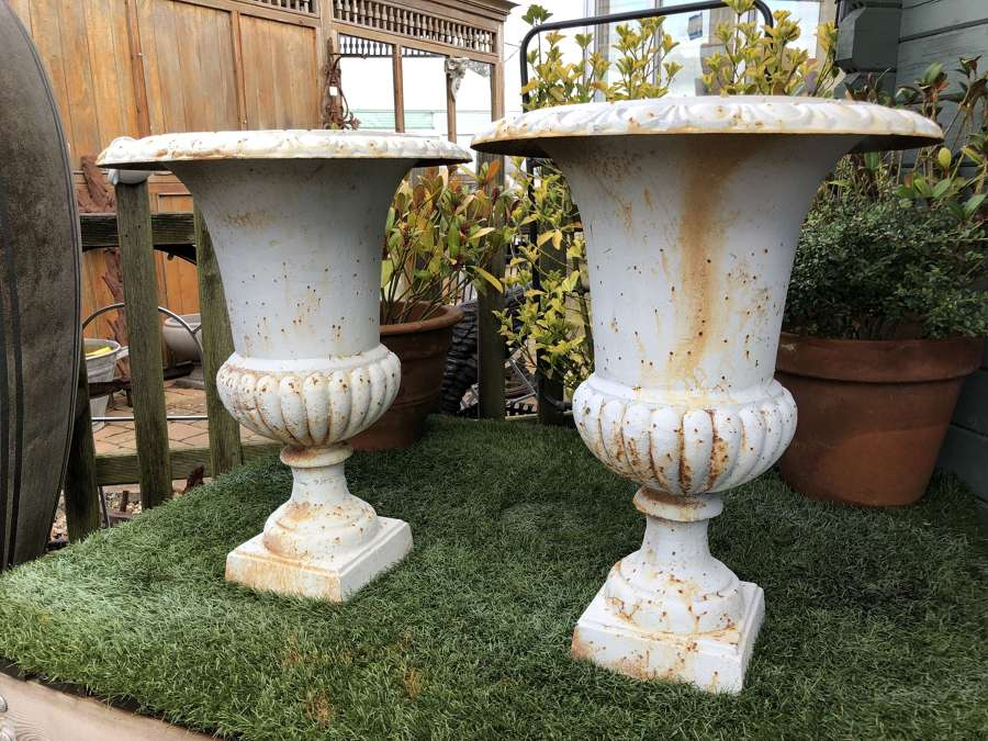 Pair of rusty white campagna urns