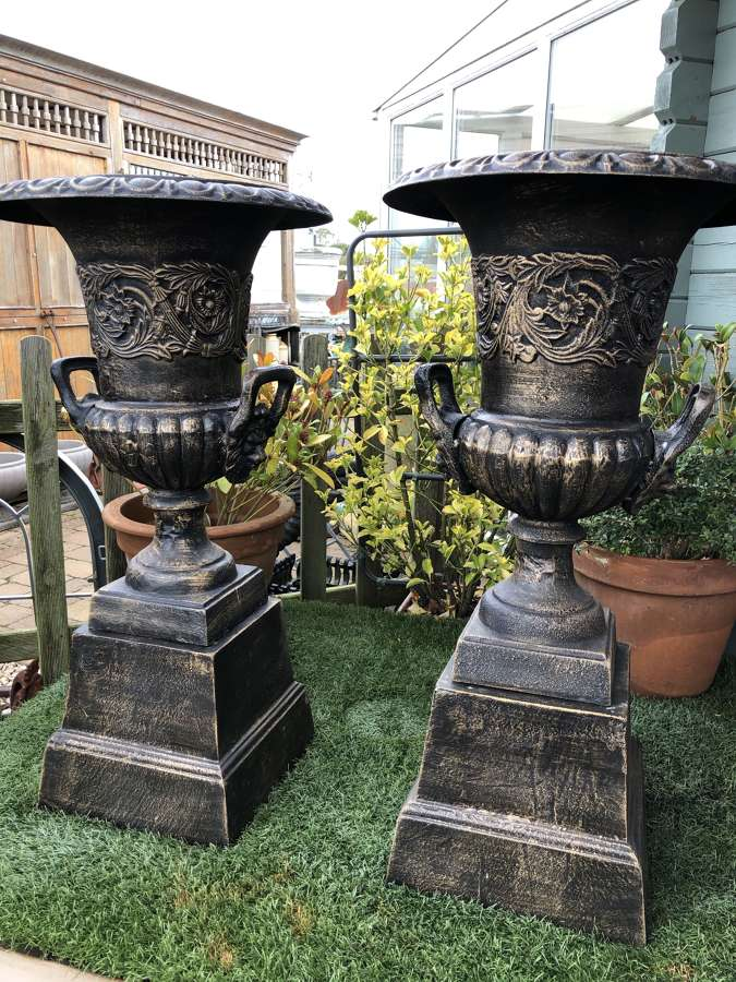 Pair of cast iron campagna urns (with handles) & plinths