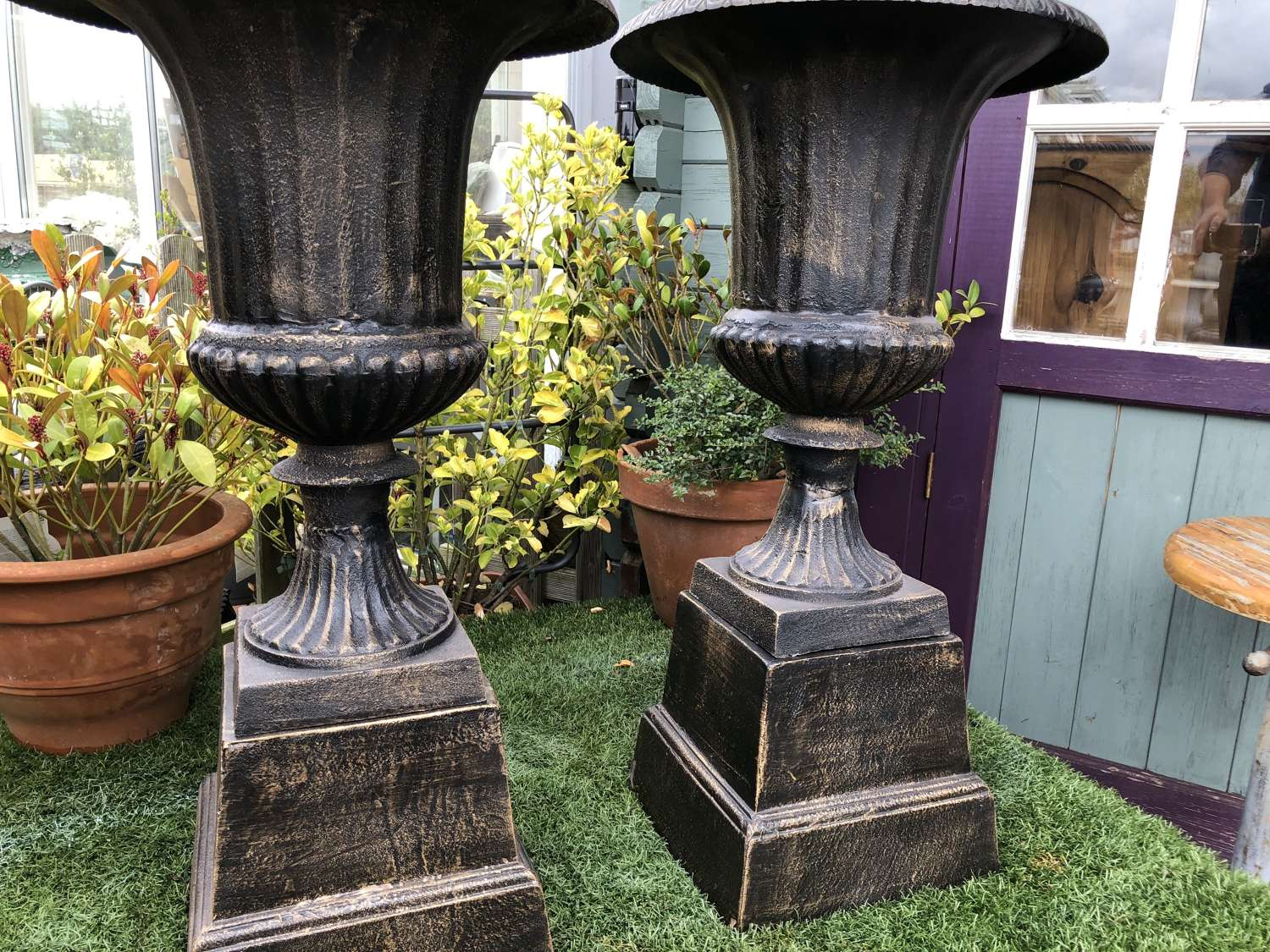 Pair of cast iron campagna urns & plinths 88 cm