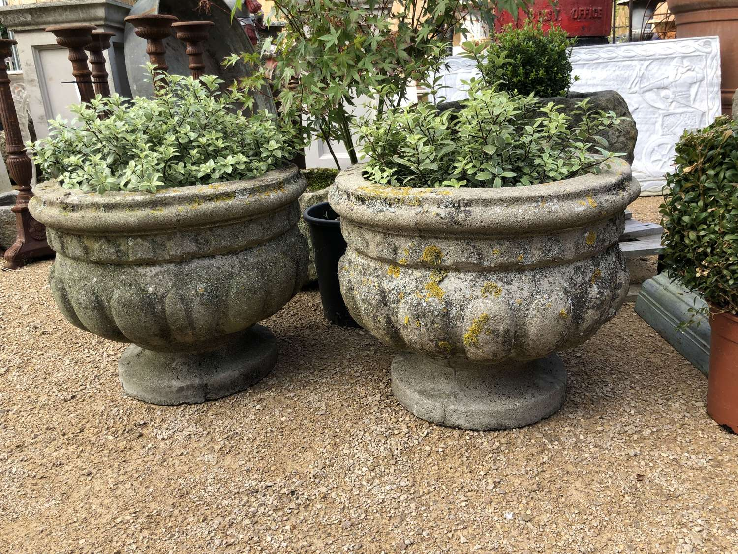 Pair of well weathered vintage stone urns